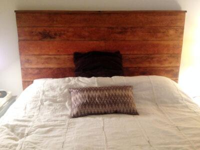 custom-made reclaimed wood headboard